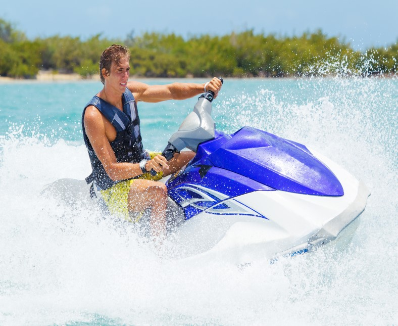 Man riding a wave rider in a tropical setting